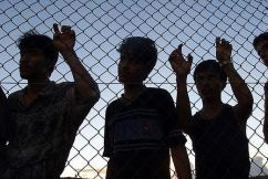 Refugees Lead Child Towards Detention Centre