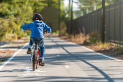 Cyclists pedaling to lift ban on footpath age limit