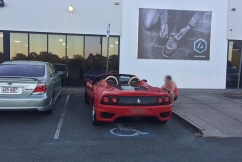Ferrari parked in designated disabled parking spot used by elderly gym users