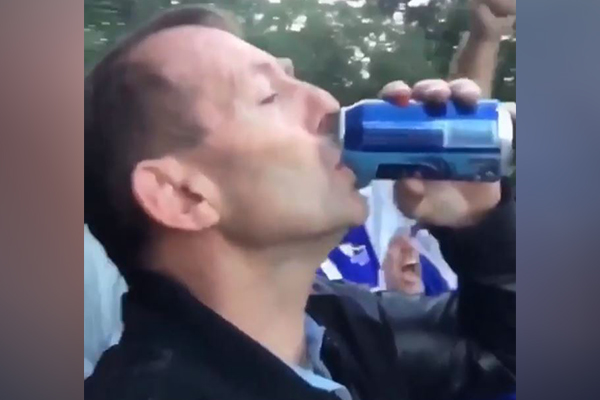 Article image for WATCH | Former PM knocks back a beer at the footy