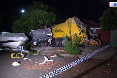 Garbage truck ploughs into family home