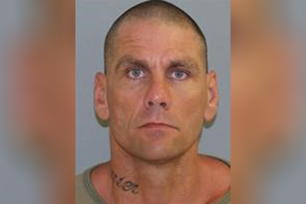 Article image for Police search for siege gunman following murder in Brisbane's north