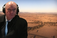 Alan Jones broadcasts from the bush