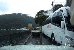 Coach bus ignores road signs, smashes three windows