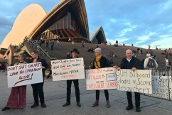 Police ramp up security for Opera House light show as protesters gather