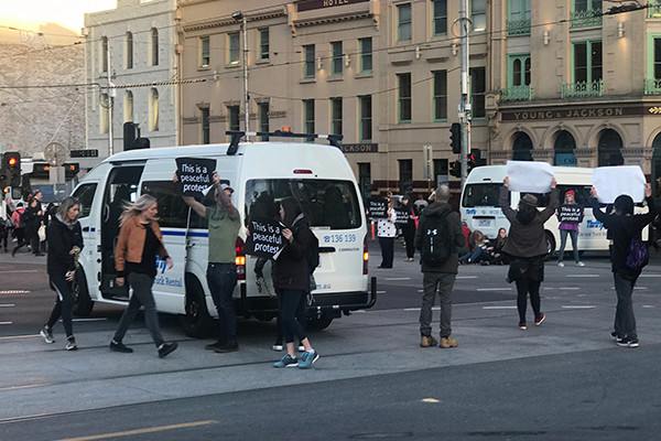 Article image for Dozens arrested as vegan activists' cause chaos across Australia