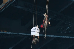 Climate activists abseil from the Sydney Harbour Bridge