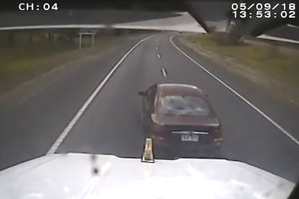 Article image for WATCH | Car tangles with truck in dash cam video