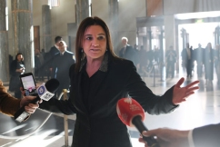 Jacqui Lambie holds out on tax cut decision