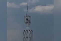 Two people climb to the top of Sydney tower