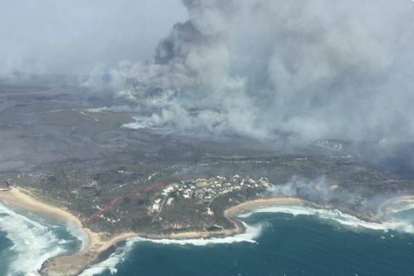 Article image for Bushfire threat far from over despite easing conditions