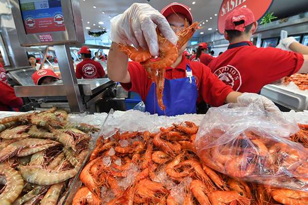 Article image for Aussies flock to Sydney Fish Market for final hours of Christmas sale