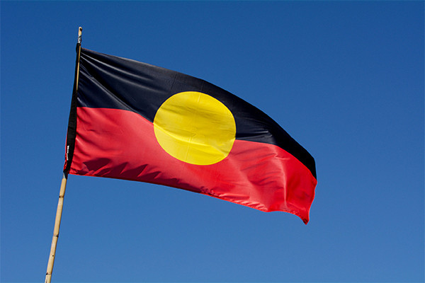 Article image for Aboriginal flag 'held to ransom' as clothing company stands by copyright