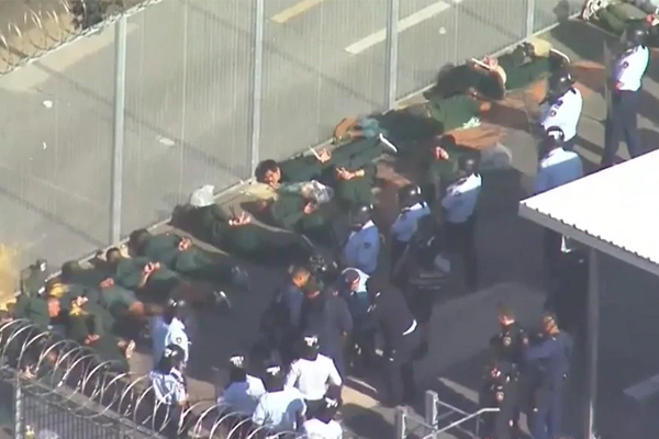 Article image for 'That's very regrettable': Long Bay locals flee from tear gas used in prison riot