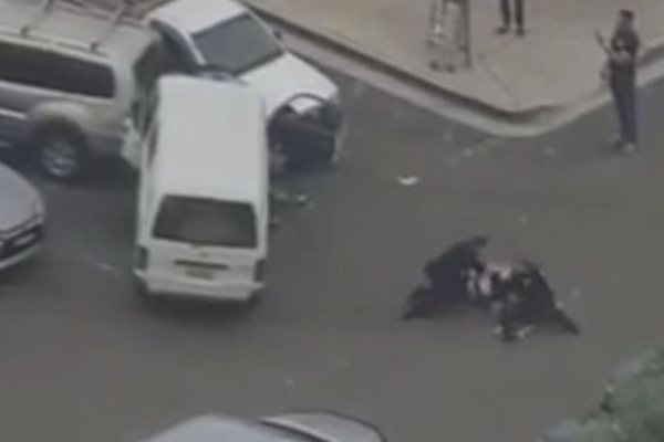 Article image for Guns drawn: Driver smashes into several cars during Bankstown pursuit
