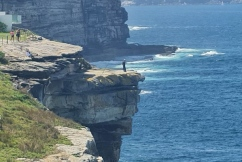 'Moron' spotted fishing off cliff edge in Sydney's east