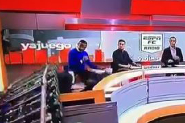 Article image for Horrifying moment journalist crushed by set on live TV