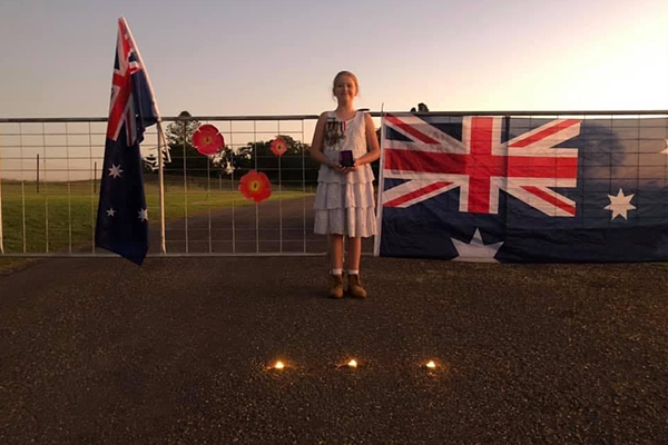 Article image for 10-year-old 'lights up the dawn' for ANZAC Day