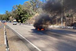 Motorcyclist's remarkable escape as bike explodes into flames